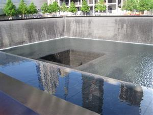 The memorial pool brings a bit of peace and tranquility to the 9/11 Memorial in NYC.