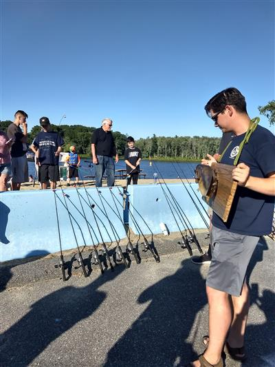 Volunteers from Massachusetts Wildlife Angler Education Program provide instruction on fishing to those who are new to the sport.
